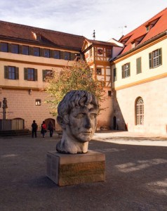 The roman statue in the courtyard of the castle