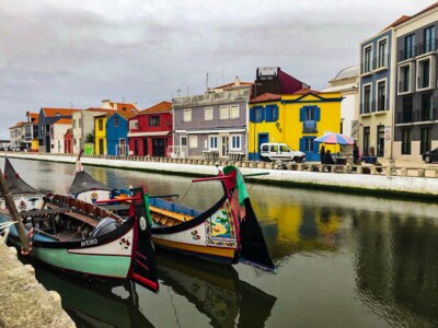A view of Aveiro, a town a short trip from Porto.  You can see the coloured houses on the other sides of the water and two coloured gondolas.