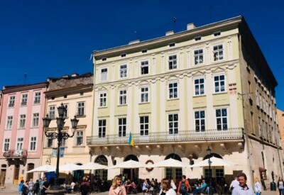 Lviv's Rynok Square with its pastel coloured buildings and outdoor cafes and restaurants