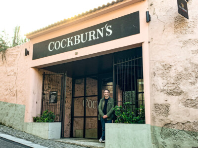 An image of one of us outside the Cockburn's port cellars before our port tasting visit