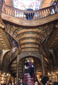 The ornate wooden staircase in the  Vivaria Lello bookshop in Porto
