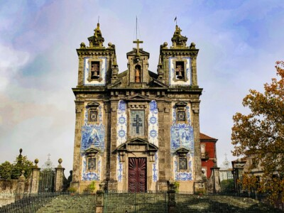 The Igregja de Santo Ildefonso church.  This is a grand building with two towers and blue tiles on the front.