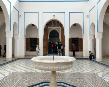 The inner courtyard with it's fountain in the middle.  This is a very white area with blue lines over archways and small patterned tiles on the floor