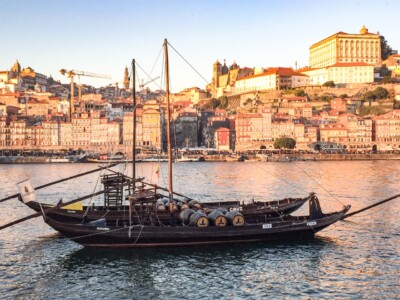 One of Porto's rabello boats on the river.  You can see the houses of Porto in the background.