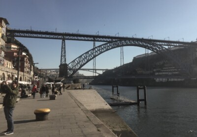 A view of the main suspension bridge in Porto from the Ribeira riverside promenade.