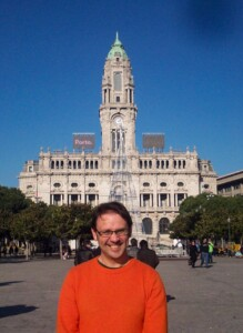 One of us in front of the town hall.  This has a large tower in the middle and there is a wide open area in front of it.