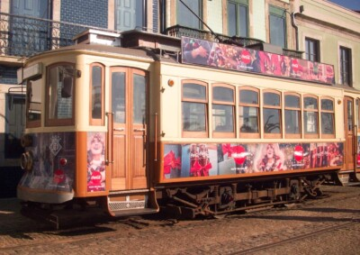 One of the old vintage trams you can ride on a Porto city break.  This one has pink coloured decorations on the side and top and will take you out to the coast.