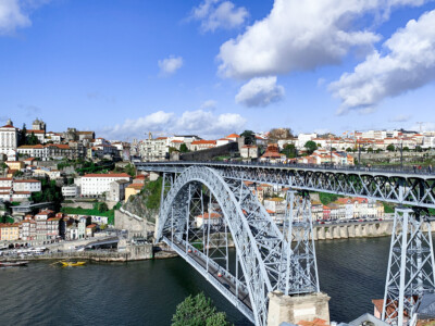 A view of Porto's suspension bridge that spans the Douro river.  You can't miss this if you choose Porto as one of your Europe trips 2021.