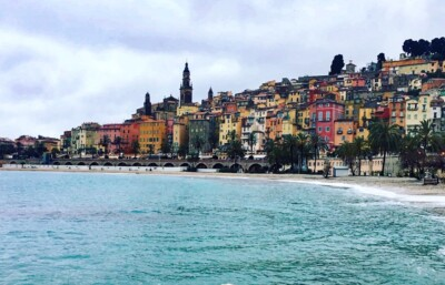 A view of the bay in Menton, France, with the colourful buildings in the background.