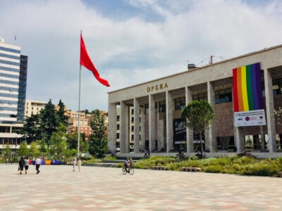 The large Opera House in Skanderbeg Square in Tirana Albania.  This has the Albanian flag flying outside it.