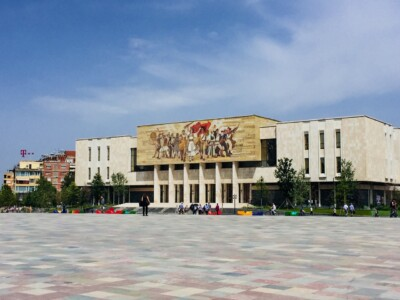 The large National History Museum in Skanderbeg Square in Tirana Albania.  You can see the wide open squad win front of this.