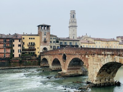 Verona's Ponte Pietra.  This is a small stone bridge with arches.  There is a tower in the background