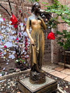 A picture of the statue of Juliet in front of her house in Verona - you must visit this if you go to Verona as one of your Europe trips 2021.