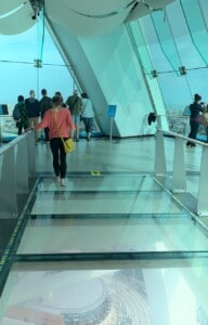 The Sky Deck glass floor with my friend walking across it