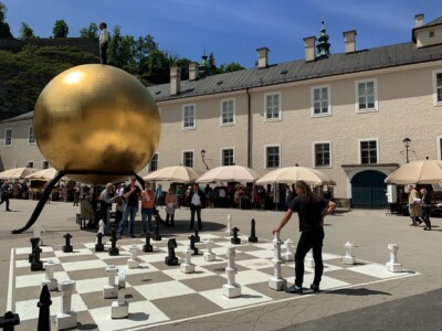 The Kapitelplatz square in Salzburg Austria, with its large golden ball and life size chess board on the ground.