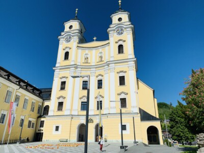 Mondsee Cathedral in Mondsee Austria.  This was used in the Sound of Music film and can be visited on a coach tour.  It is pastel yellow coloured.