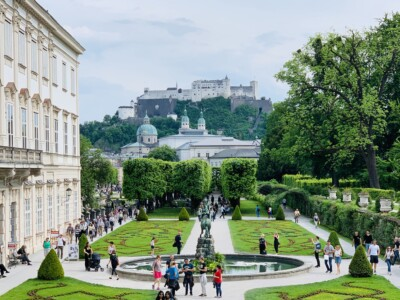 The Mirabell Palace and Gardens in Salzburg with a view of the fortress on the hill in the background.