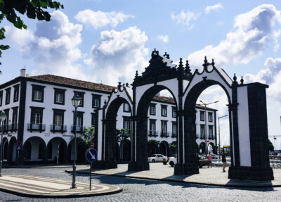 The Portas de Cidade in Ponta Delgada on Sao Miguel island in the Azores.  This has three arches and is black and white.  You will see this if you visit Ponta Delgada on one of your Europe trips 2021