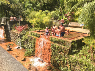 People enjoying the thermal springs in the Poca da Dona Beja spa on Sao Miguel island in the Azores