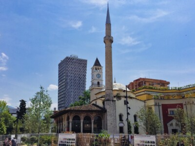 The Et'Hem Bey Mosque and the 19th century Clock Tower in Tirana's Skanderbeg Square.  This is a starting point if you visit Tirana in Albania as one of your Europe trips 2021.